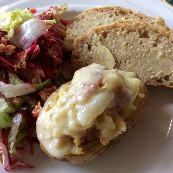 Bacon and cabbage stuffed potatoes, with a precious slice of cheese