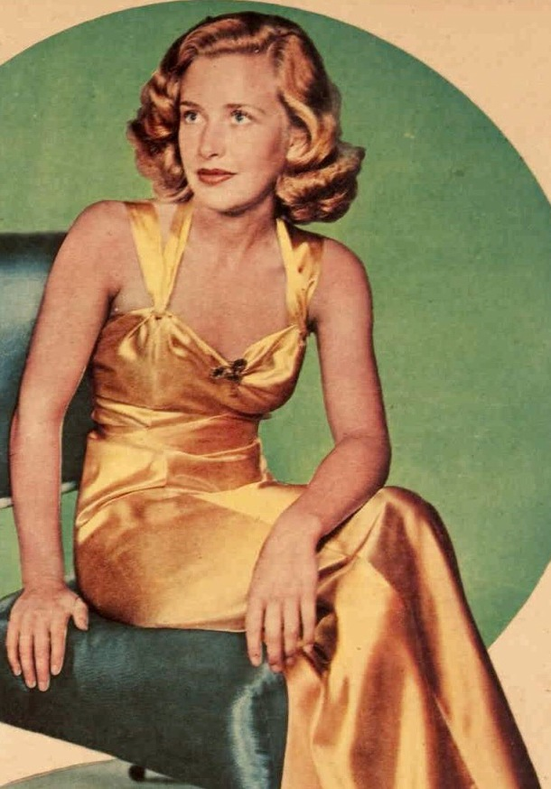 Actess Priscilla Lane in a gold evening dress, 1939