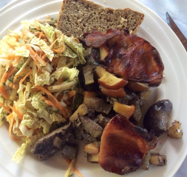Baked liver with bacon and apple. served with coleslaw and a slice of national loaf